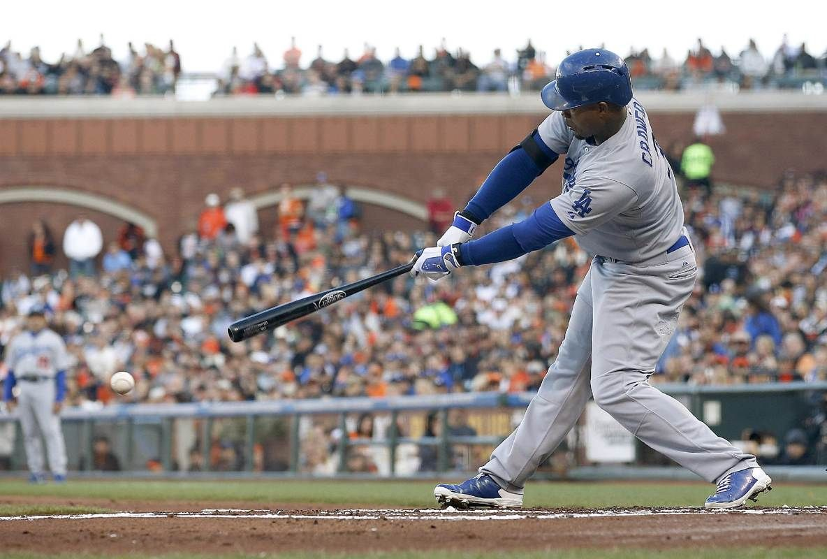 Los Angeles Dodgers' Carl Crawford hits a single against the San Francisco Giants during the first inning of a baseball game Saturday, Sept. 13, 2014, in San Francisco. (AP Photo/Tony Avelar)