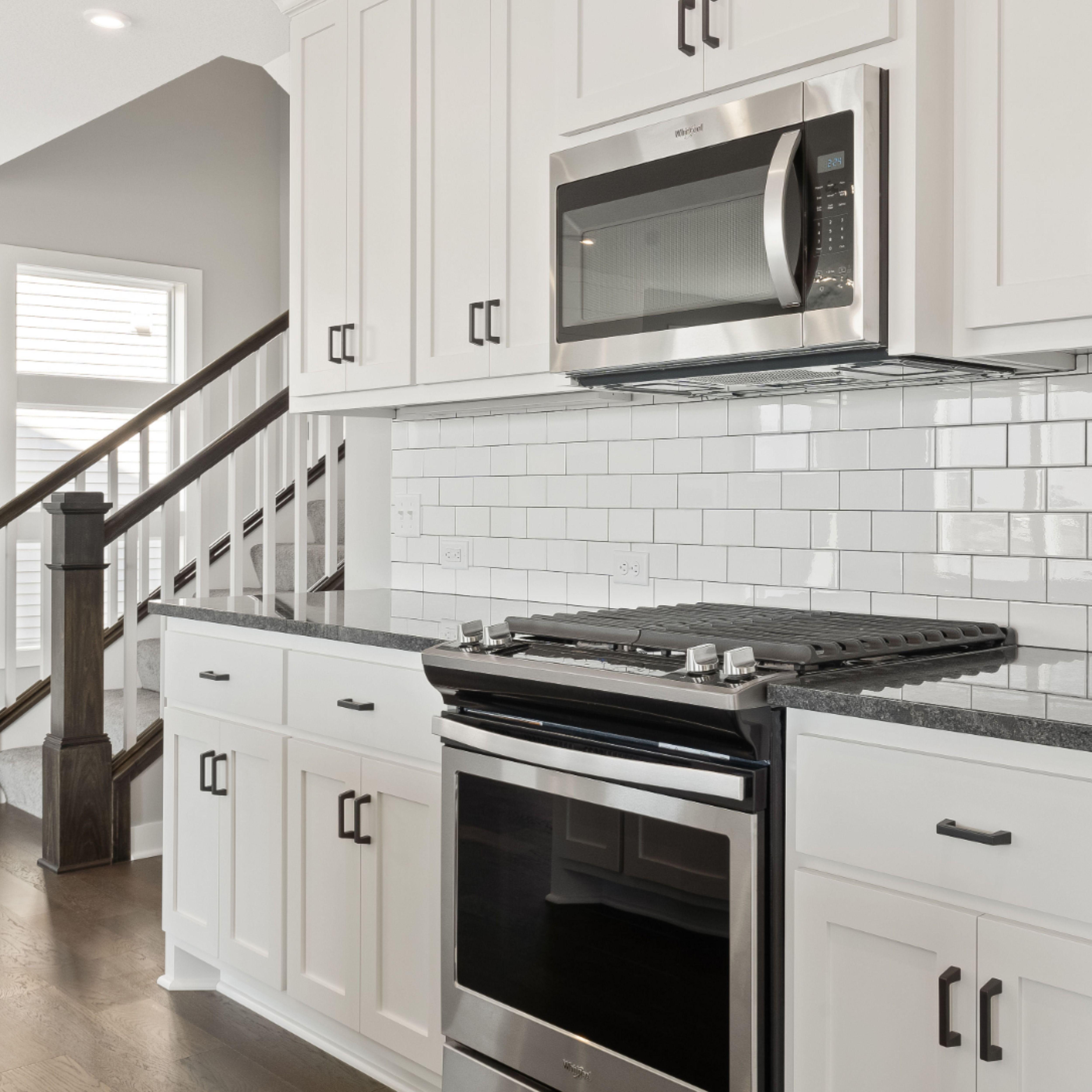 Hanson Builders Newport Kitchen Matte Black Kitchen Hardware Black Granite Kitchen White Cabinets Black Granite Kitchen backsplash white cabinets black countertop
