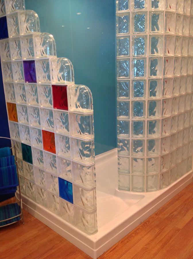 Mixed colors in a glass block shower wall with blue high gloss ...