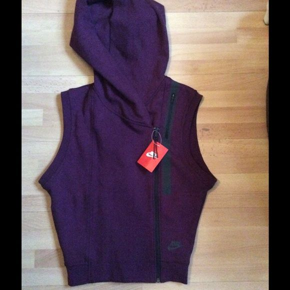 Nike Vest NWT.   Cute, cropped, asymmetrical zip vest.  Hits at waist on 5'7.  Hood, upper side zipped pocket for easy iPhone access! Nike Tops Sweatshirts & Hoodies