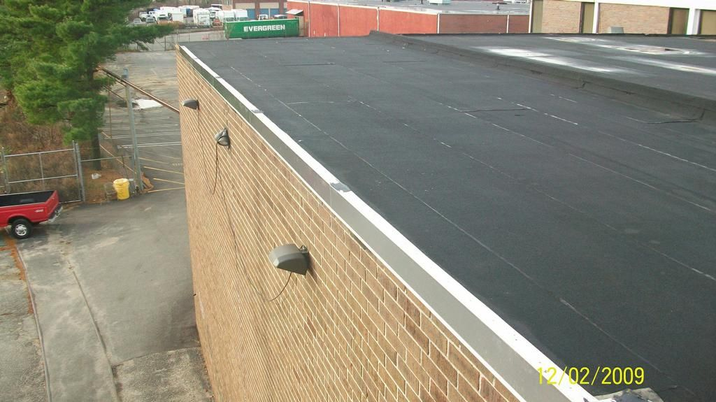 Installing New Metal Edging On A Commercial Flat Roof By Www Liroofrepair Com Roofing And Roof Repairs Long I Flat Roof Repair Commercial Flat Roof Roof Repair