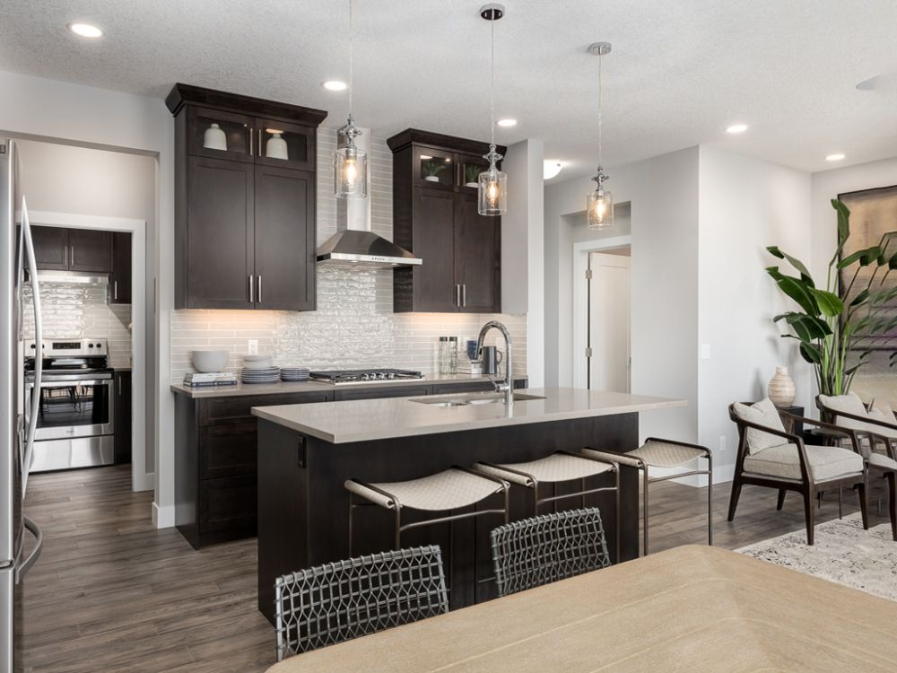 This Kitchen Is Open And Has An Awesome Kitchen Island Hawthorne Savanna Kitchen Design By Excel Homes Home Kitchen Show Home Home Kitchen Island With Sink