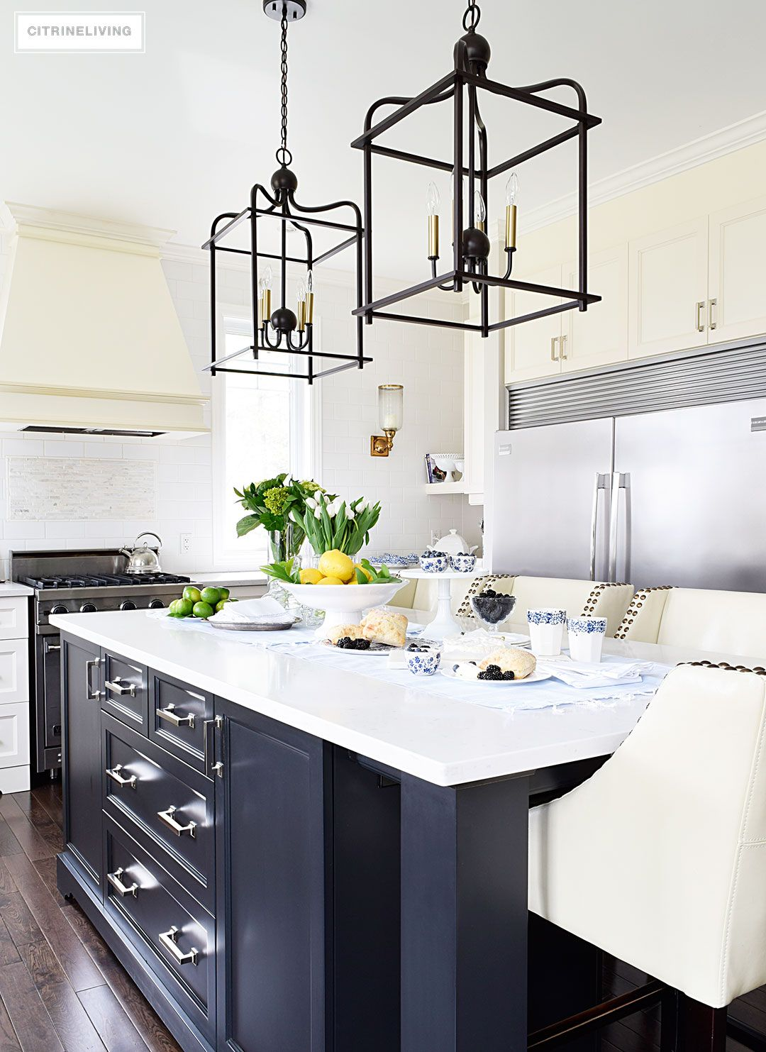 A white kitchen with a welcoming tablescape of blue and white ...