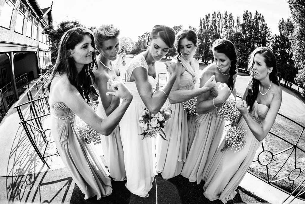 Bridesmaids And Bride Flexing Kristen Borelli Photography Victoria Golf Club Wedding Photographer
