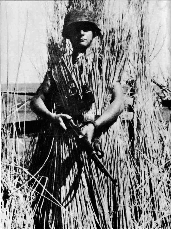 A Camouflaged German Soldier And His 8mm Mauser K98