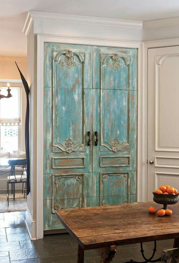 Salvaged French doors conceal appliances—a clever solution conceived ...