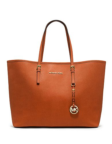 Polish your look with this timelessly chic travel tote by Michael Michael Kors! #lordandtaylor #projectrunway