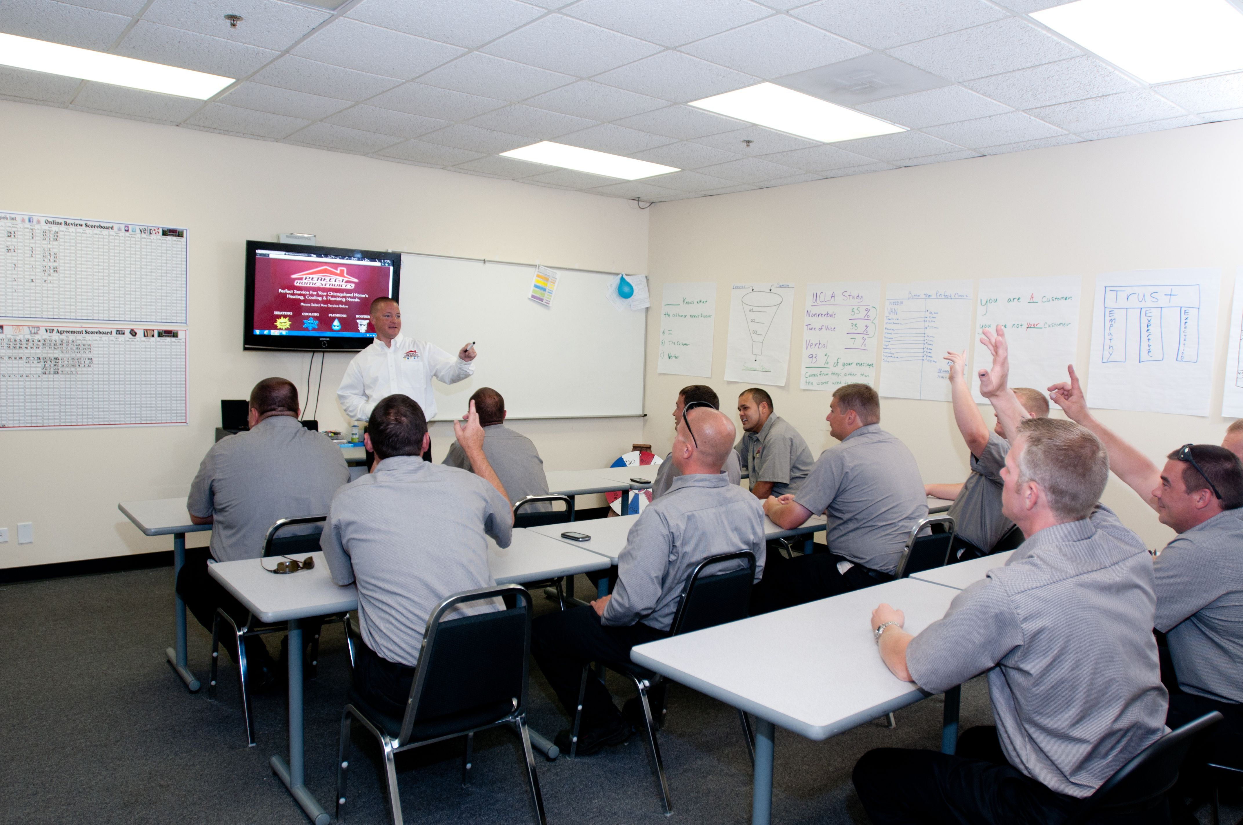 Blake Teaching A Class On Customer Service
