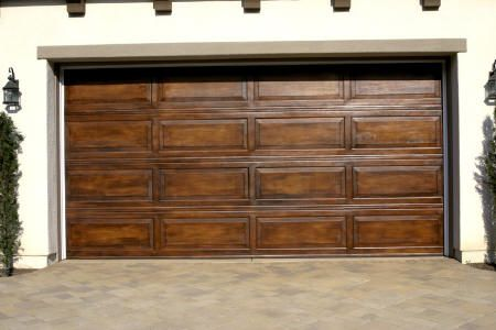 Love this idea it 39 s a standard metal garage door painted for Faux wood grain garage door painting