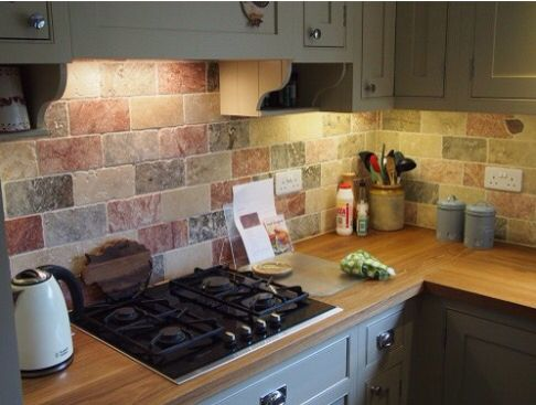 Kitchen Splash travertine wall tiles used as a splash back | kitchen splash back