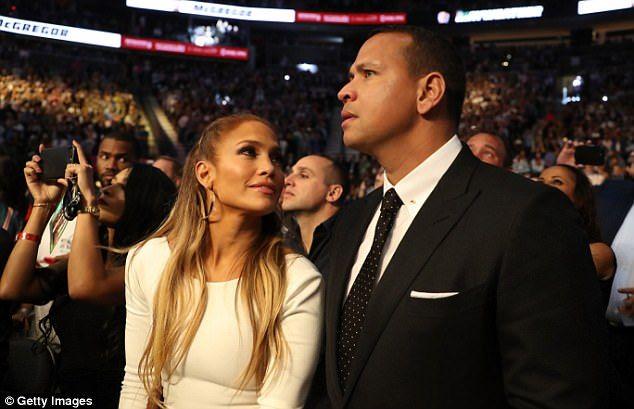 Jennifer Lopez gazes at boyfriend Alex Rodriguez ...