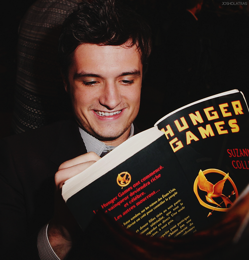 The thought of this picture makes me breathless, but actually seeing it.... I JUST Died!!! ( he is probably reading about Peeta... Which makes it even BETTER!!)