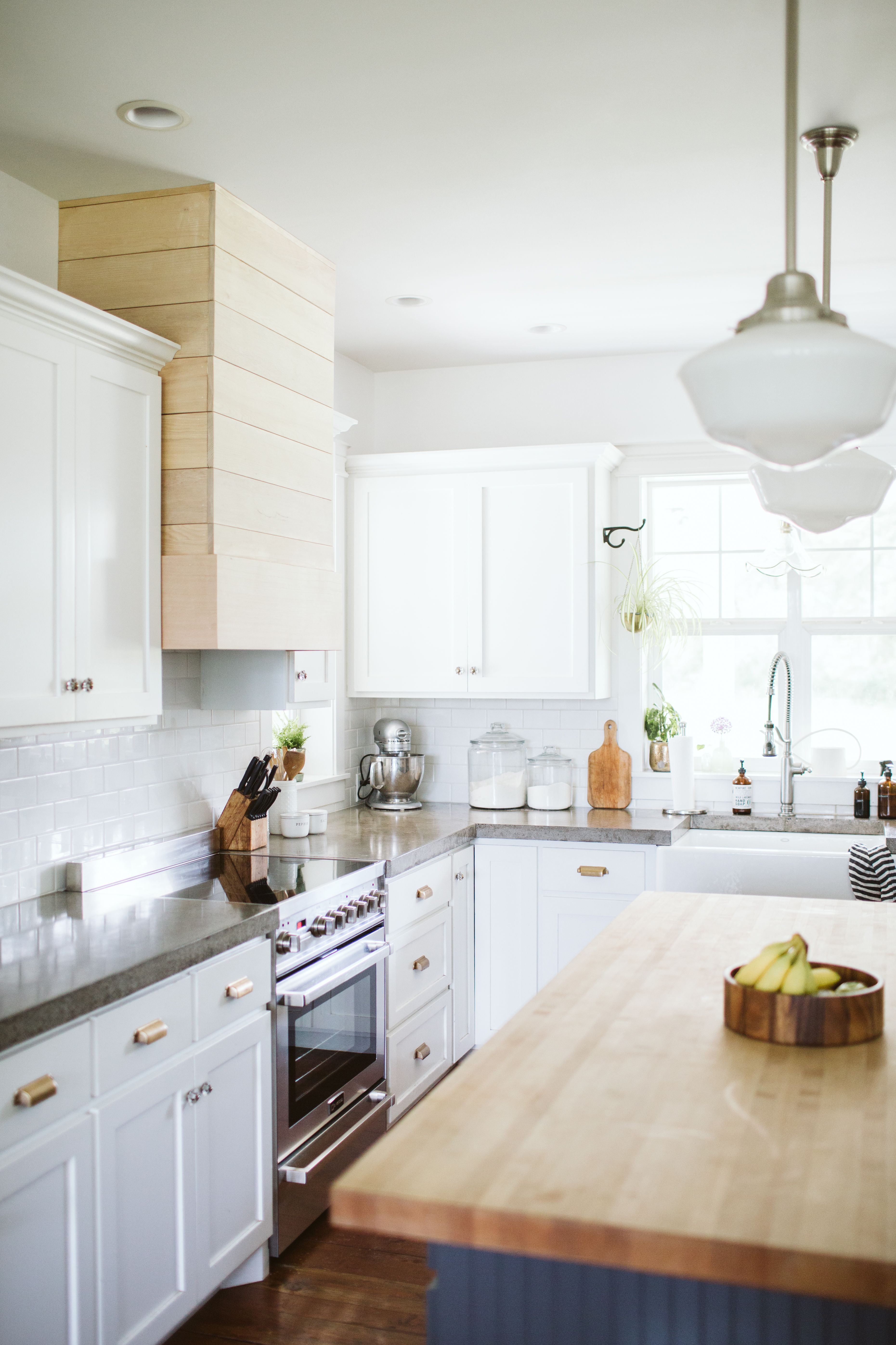 Bright white modern farmhouse kitchen featuring a Verona ...