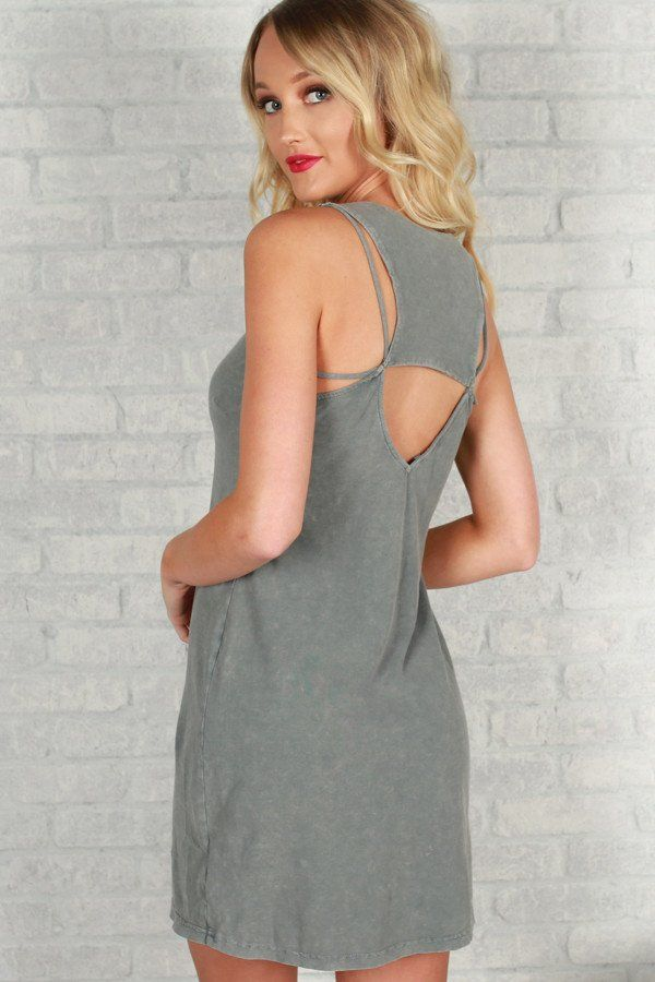 We're in love with this subtle but sassy mini! This casual spring or summer dress has the best back detail with all it's little straps and cut outs. Pair with some sandals or slides and you'll be the perfect combination of casual and cute!