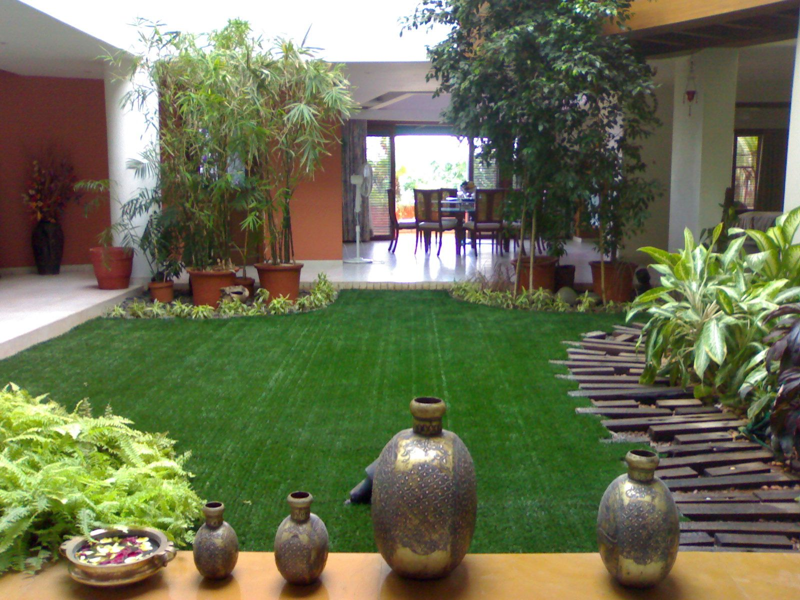 A Beautiful Garden Adorned By Our Artificial Grass Inside A House In Hyderabad India See More Such Garden Ideas India Indian Garden Artificial Grass Balcony