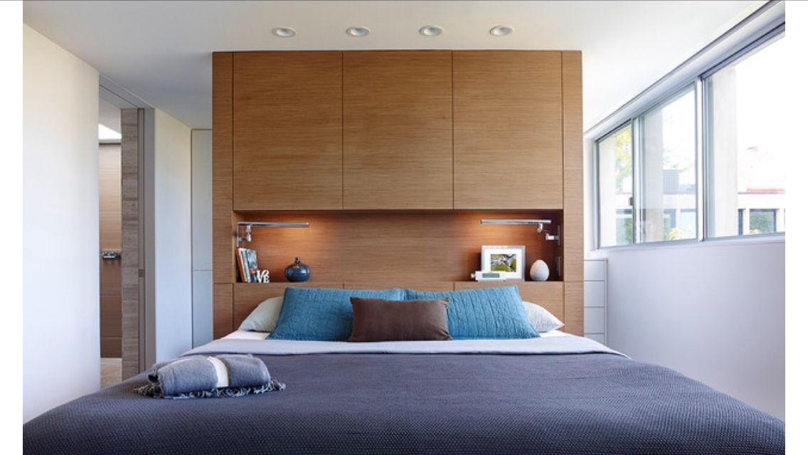 walk in wardrobe behind bed  bedroom wall shelves in