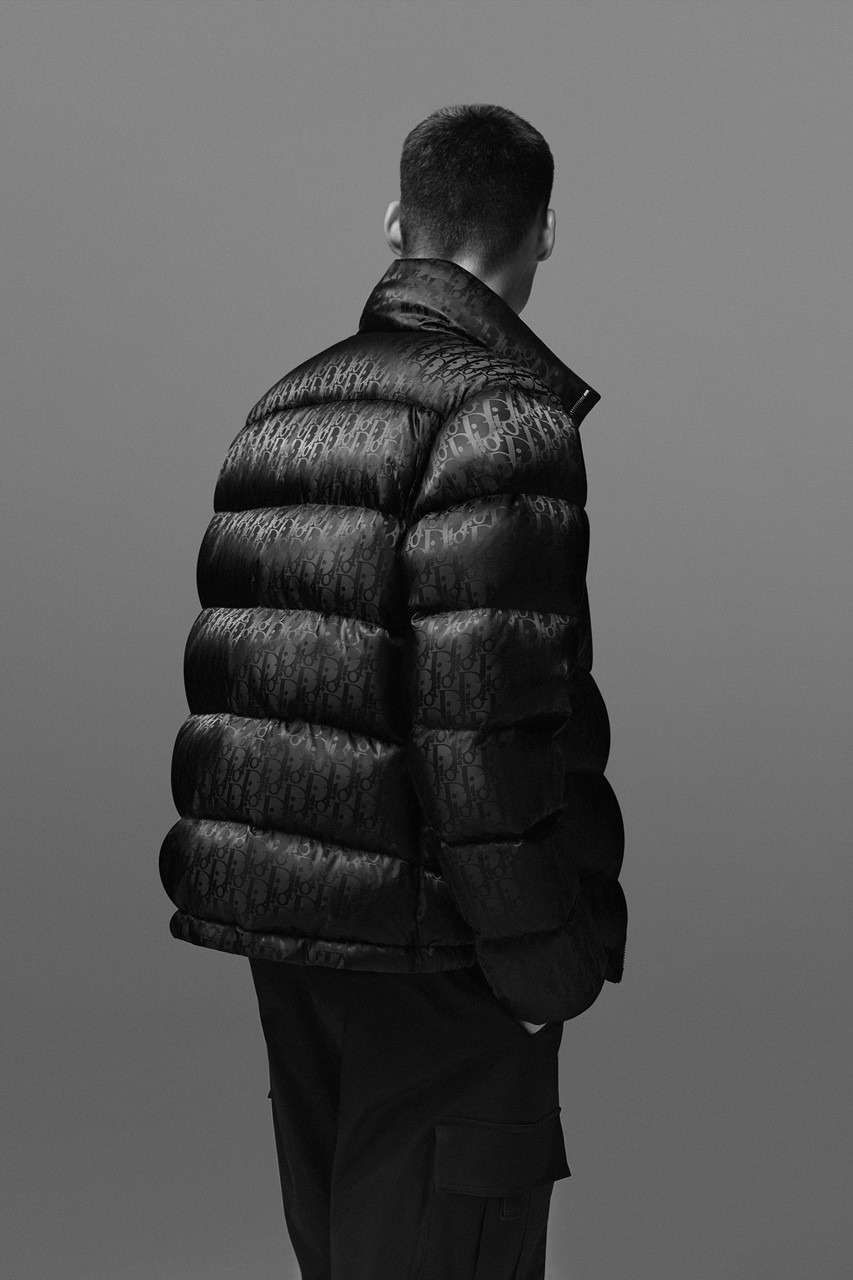 Dior S New Essentials Men S Line Delivers Sleek Looks For Day And Night Mens Puffer Jacket Puffer Jacket Men Mens Essentials [ 1280 x 853 Pixel ]