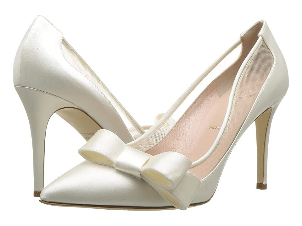 Kate Spade New York Lizzi (Ivory) Women's Shoes. For the most special of occasions  ring fashion's bell of grace and beauty with the Kate Spade New York Lizzi pumps. Glamorous satin upper. Slip-on design. Tonal mesh panel. Offset signature bow. Pointed toe. Smooth leather lining. Lightly padded leather footbed with printed brand logo. Wrapped heel. Durable leather outsole. Made in Italy. Measurements: Heel Height: 3 1 2 in Wei #KateSpadeNewYork #Shoes #OpenFootwear #GeneralOpenFootwear #White