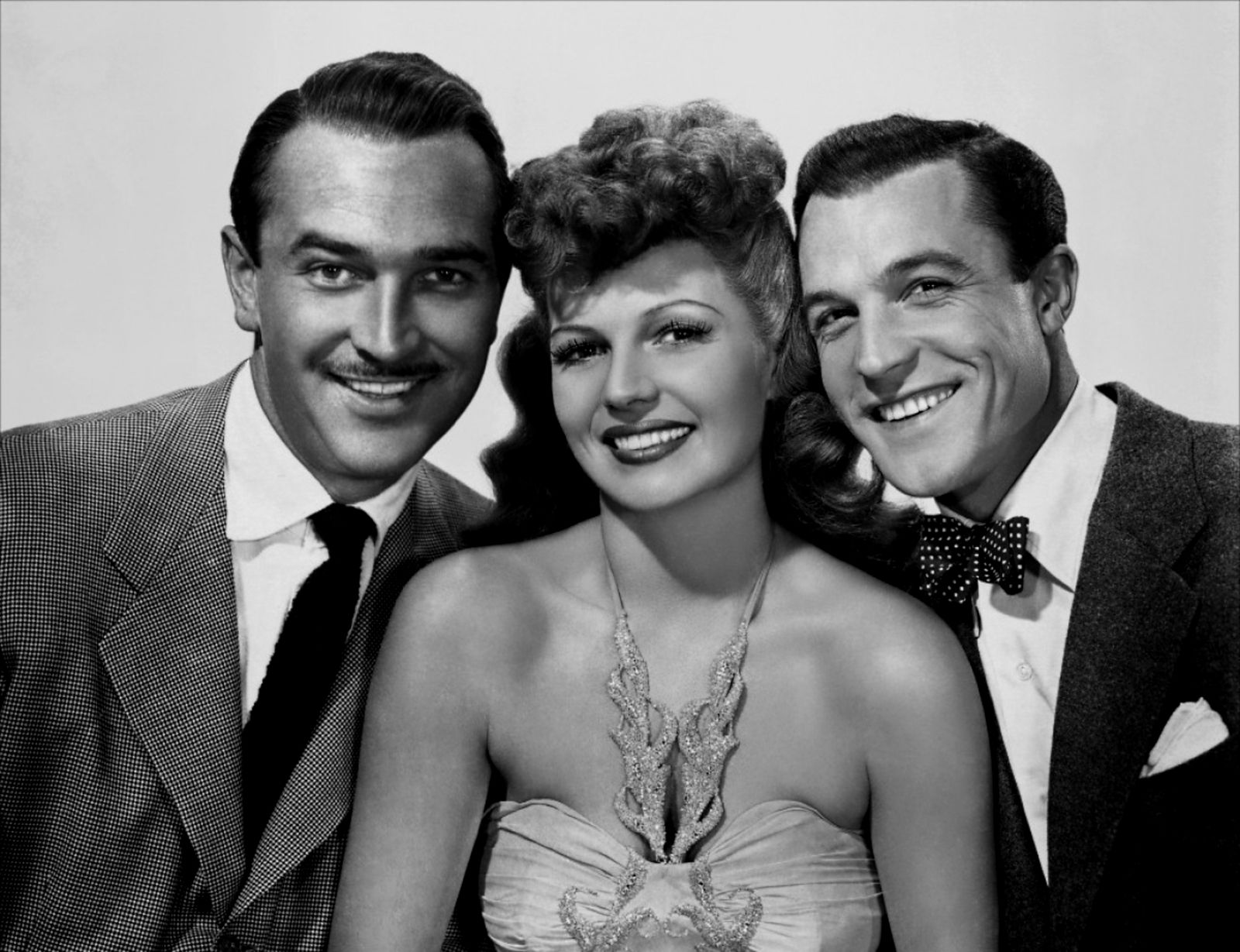 (L to R) Lee Bowman, Rita Hayworth and Gene Kelly (With