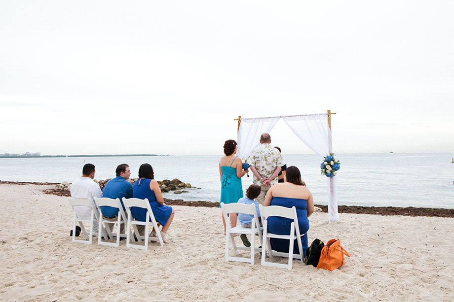 Small Beach Wedding In Miami Florida All Fl Decor Bamboo Arbor Officiant