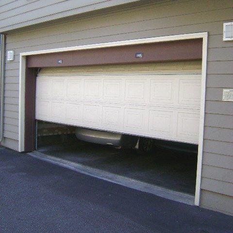 How To Troubleshoot A Garage Door When It Isn T Opened Garage Doors Garage Door Springs Garage Door Installation