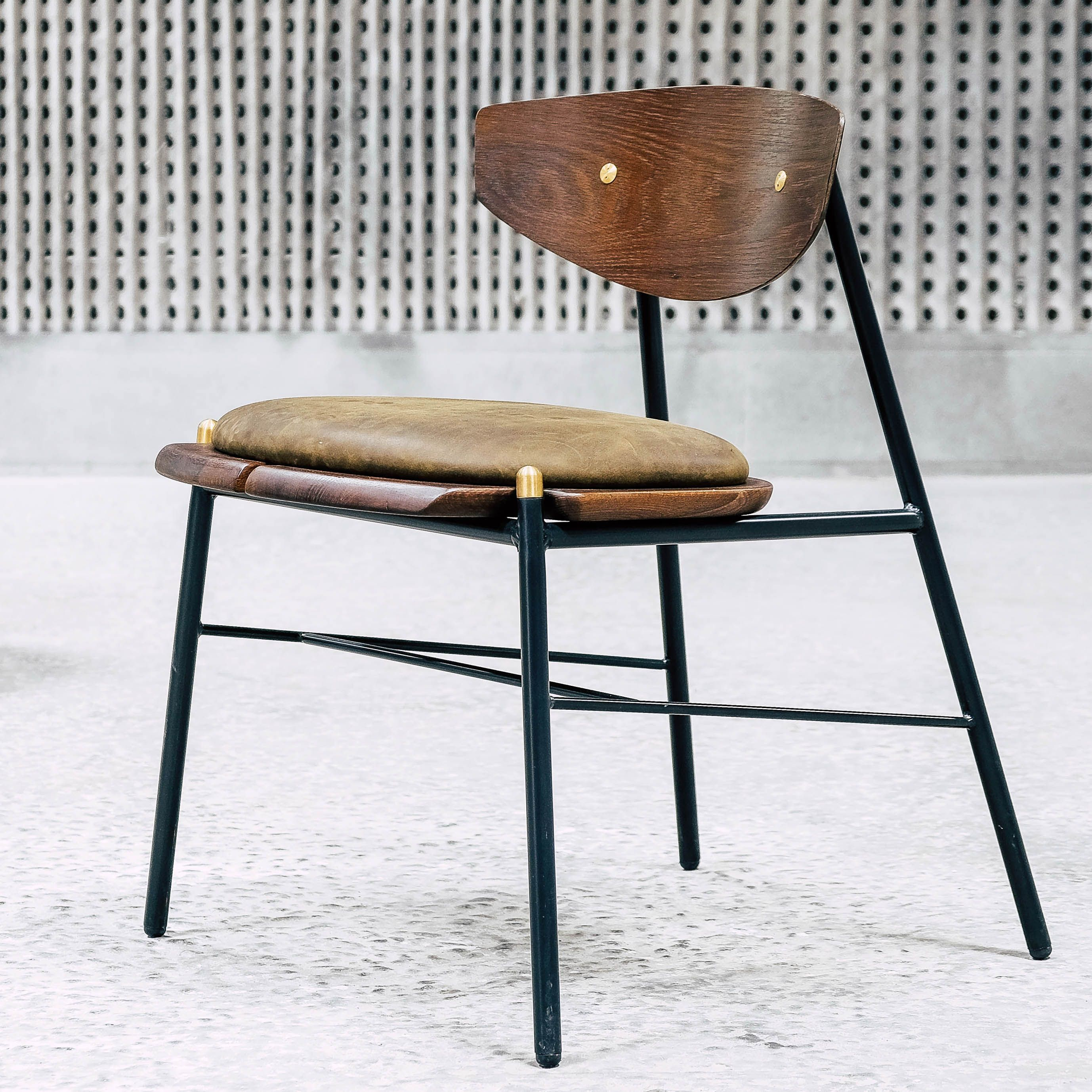 DistrictEight | The Kink Dining Chair, handcrafted with a blackened ...