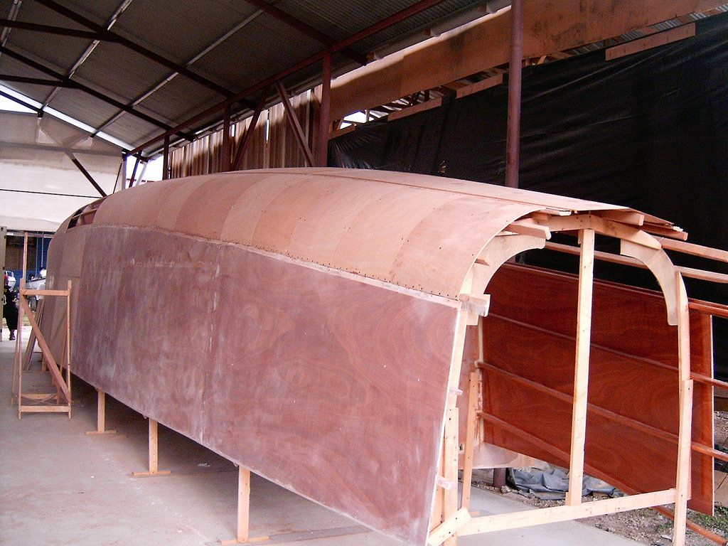 DH550 plywood catamaran - hull sides & bottom skinned, first layer of radius fitted. | BOAT ...