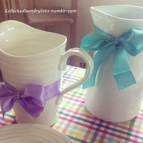 Dressing up the juice jugs with big bows!    http://collectedlaundrylists.tumblr.com/post/21331141136/babyshower
