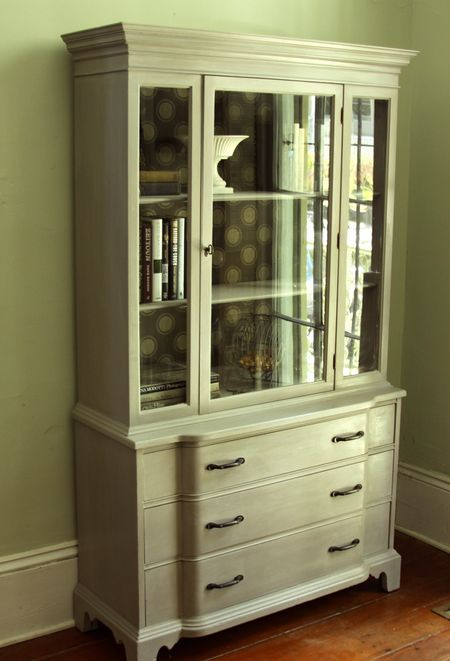 Love the milk paint on this mahogany china cabinet! Good wallpaper choice for the background, too.