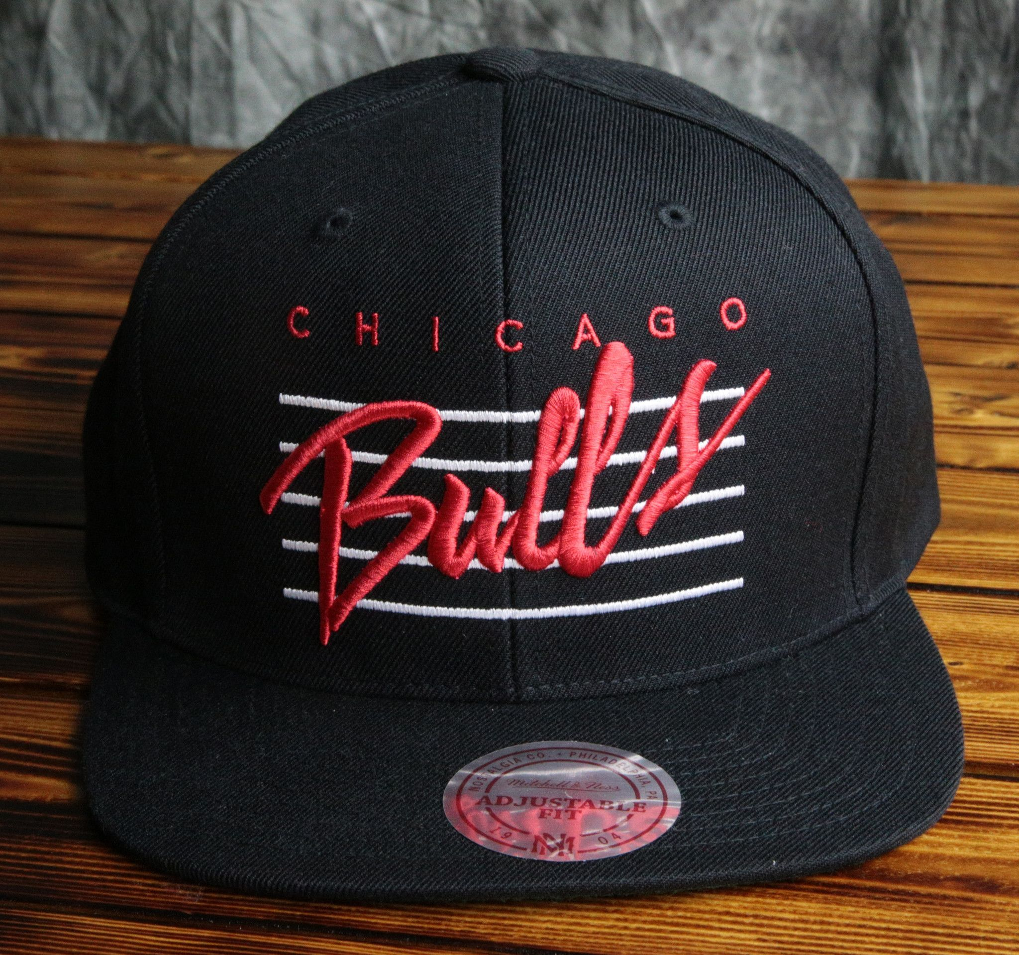 hot sale online c1c43 0253c Chicago Bulls Mitchell   Ness Cursive Retro Script Snapback Hat