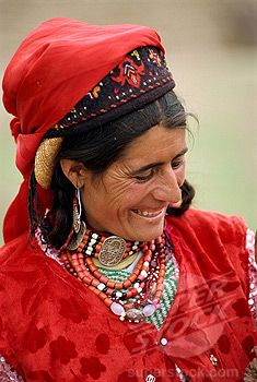 China | Portrait of a Tajik woman with hat and jewellery at Tashkurgan, Xinjiang | ©Robert Harding Picture Library