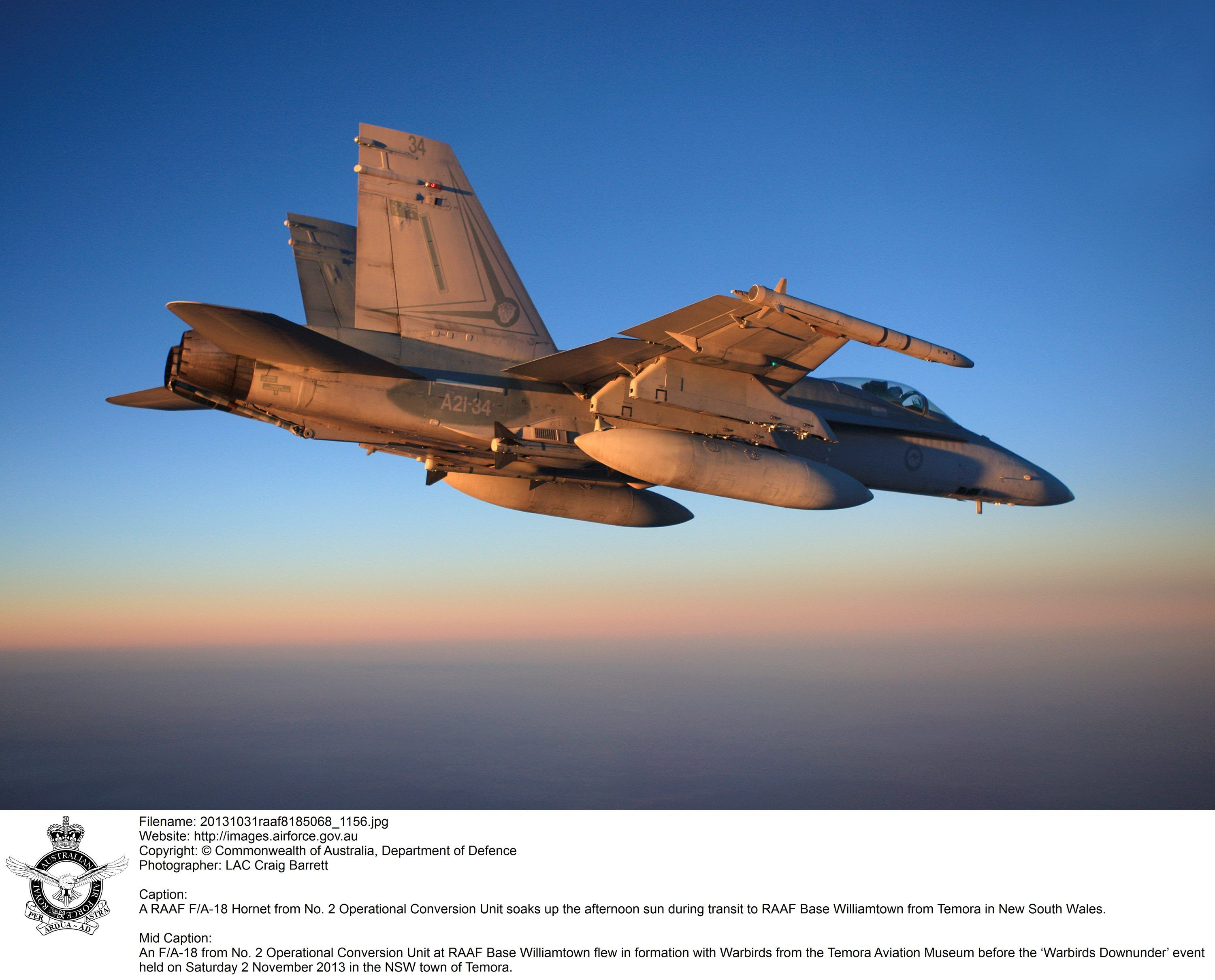 A RAAF F/A-18 Hornet from No. 2 Operational Conversion Unit soaks up the afternoon sun during transit to RAAF Base Williamtown from Temora in New South Wales.