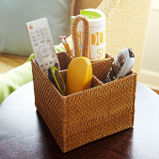 Control Station: Corral coffee table runaways with a basket organizer. This simple basket is stylish enough to sit out on the table and it keeps everything in one spot so when you want to change the channel, you'll always know where to find the remote. Look for a basket with compartments, like a utensil organizing basket.