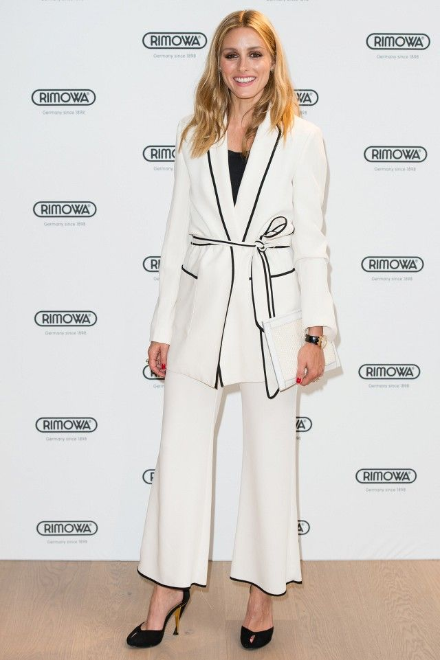 f76f990ab1ee Olivia Palermo styled the white suit with black peep-toe pumps and a sleek  white clutch. Under the wrap blazer