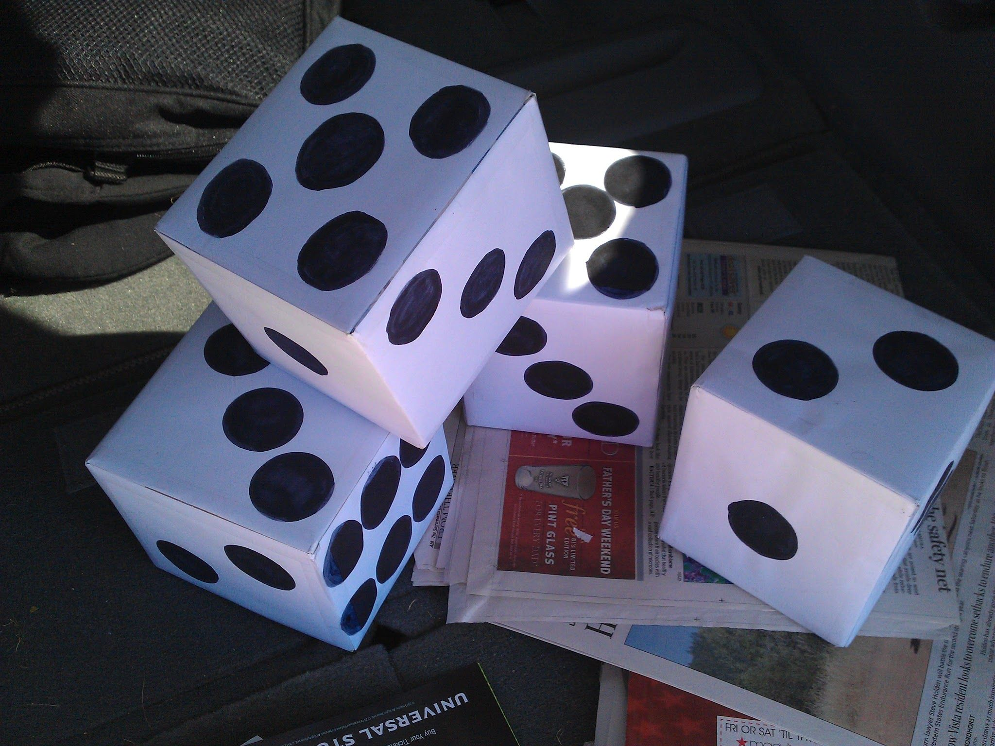 Easy to make dice- cover kleenex box with printer paper and print out die dots or draw them on :)