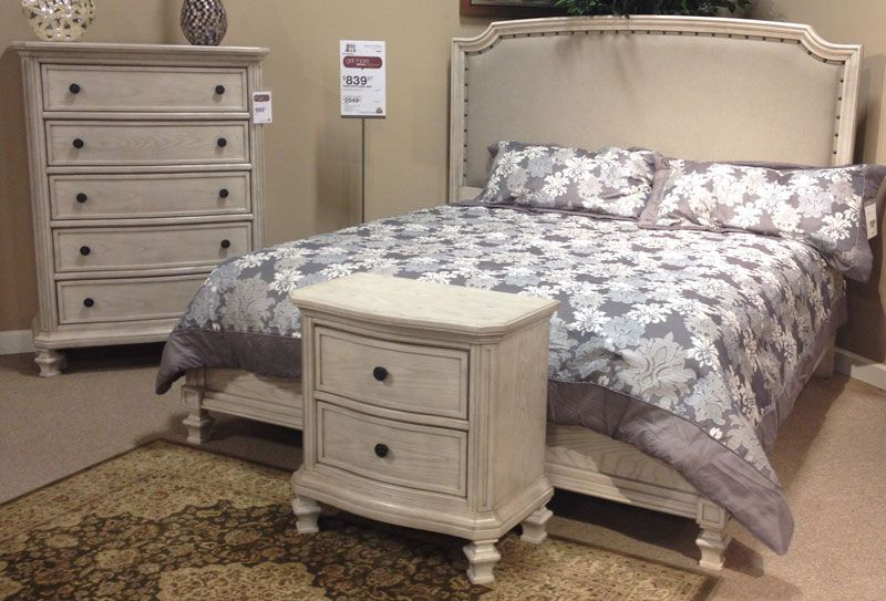Demarlos parchment white king panel bed with the rustic beauty of the gently distressed for Demarlos upholstered panel bedroom set