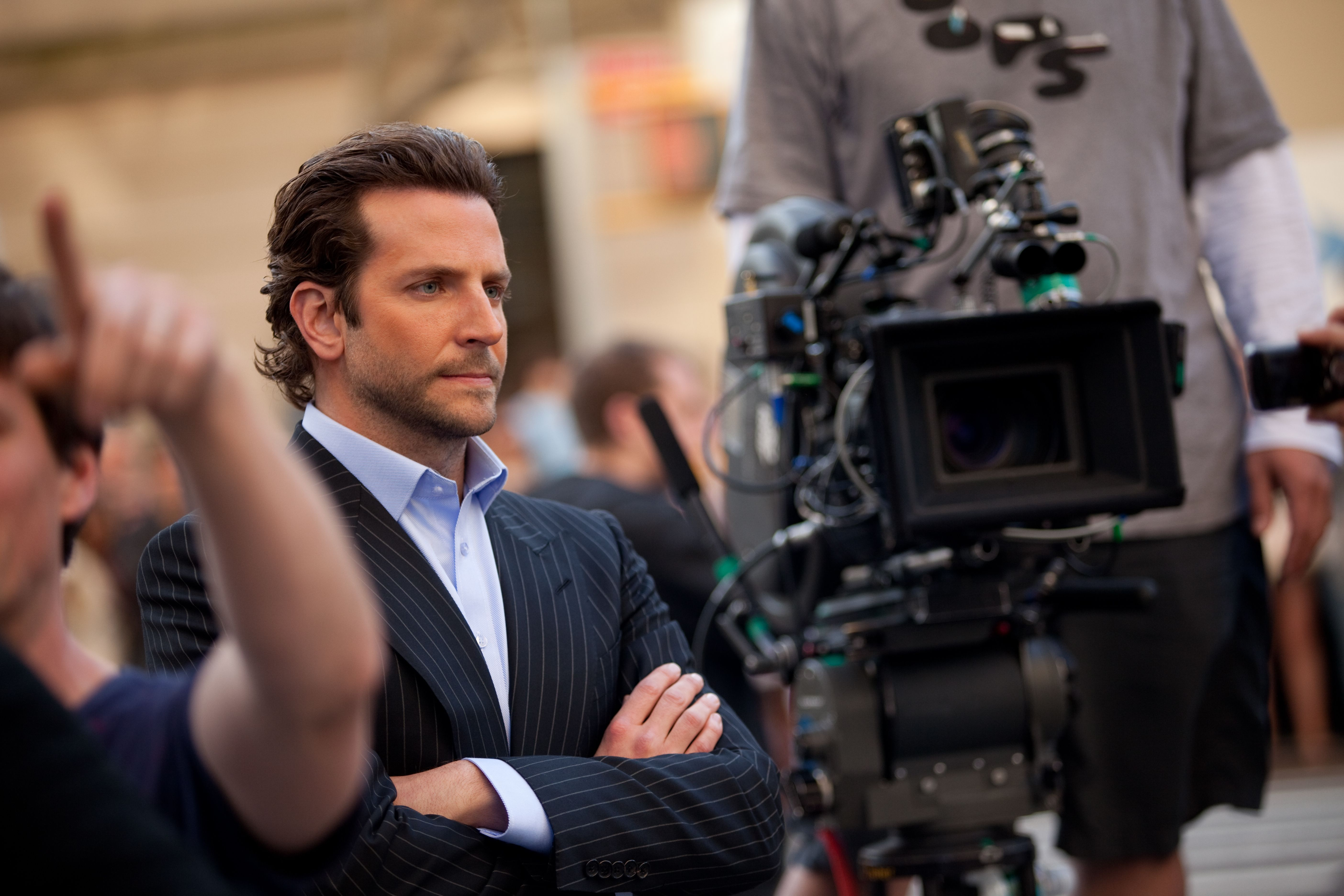 Bradley Cooper waits for the next shot on the set of