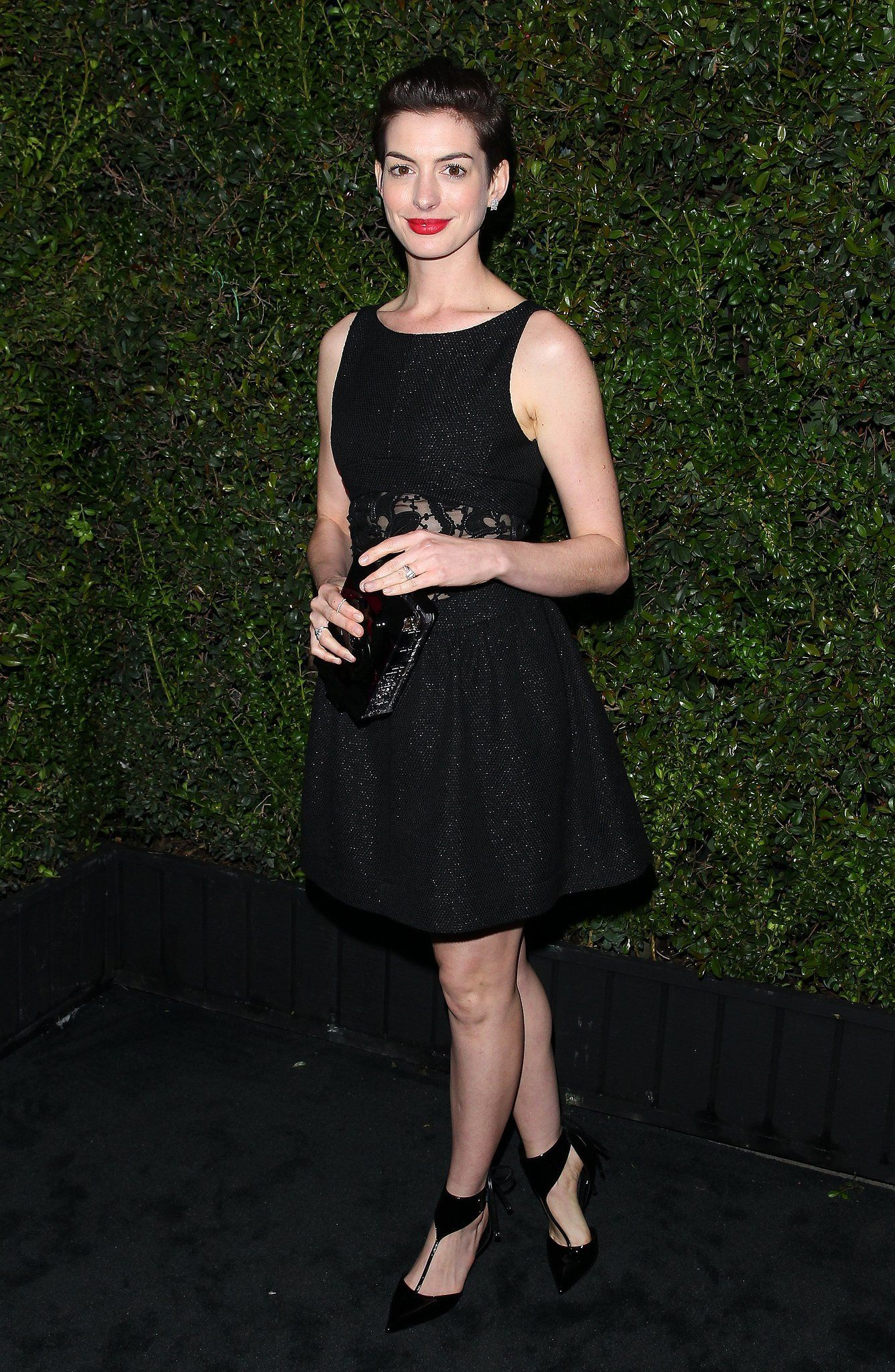 Anne hathaway kept it simple in a black dress at chanelus preoscars