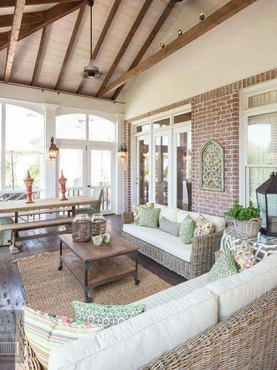 Lovely but functional screened in porch love the exposed for Screened porch furniture layout