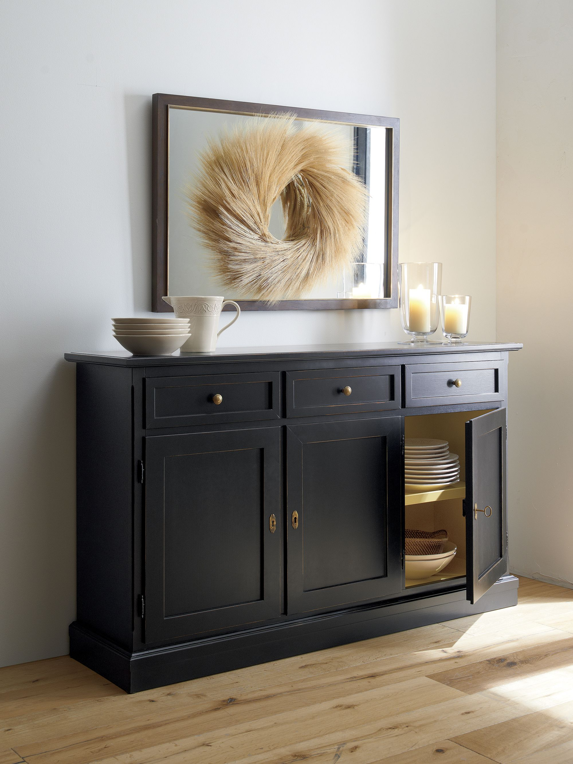 Pranzos generously proportioned sideboard is crafted from solid european hardwood and tanganyika walnut hand distressed in our rustic black finish with