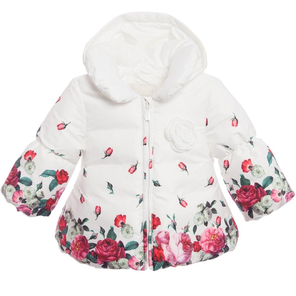 Baby girls white Jacket by<span>Minibanda made in a silky polyester with soft padding. It has a cute elasticated bubble hem and cuffs with a pretty roses print. The lovely padded collar means it is soft and warm around your little ones neck and it has a detachable hood. It has a pretty white rose appliquéon thechest and a full zip fastener on the front.<br /></span> <ul> <li>100% polyester (silky padded feel)</li> <li>Lining: 100% polyester (silky feel)</li> <li>Paddi...
