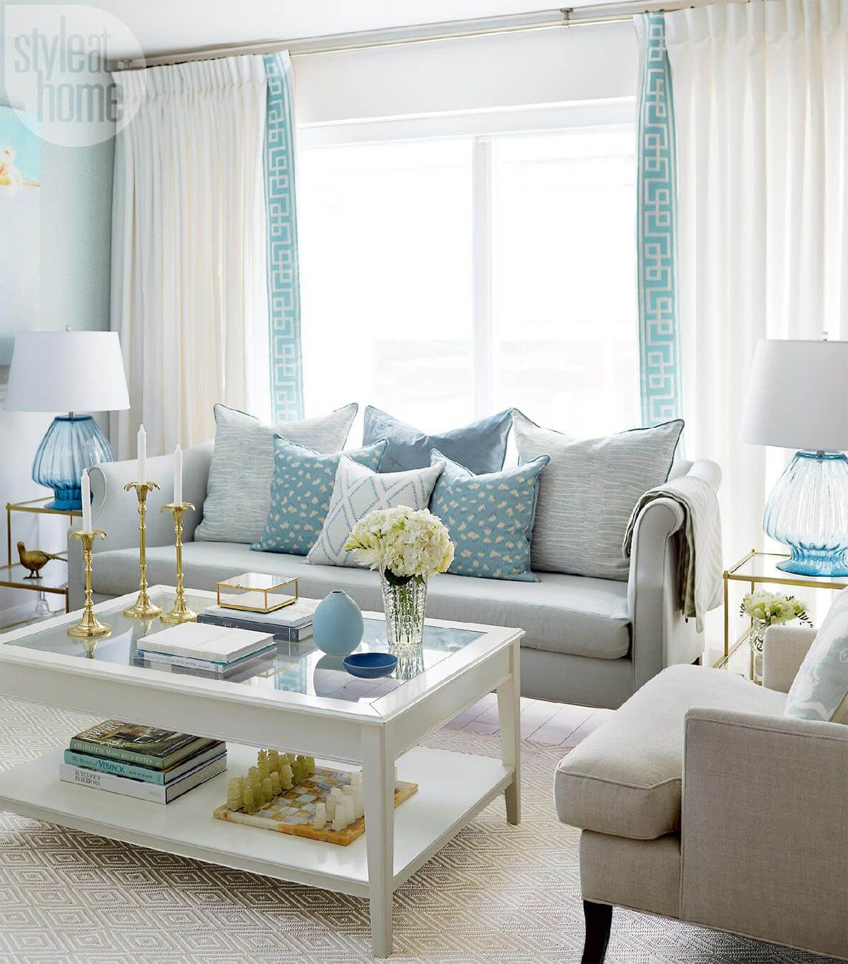 Photo of Blue Accents Against Warm Brown for a Summer Cottage Feel