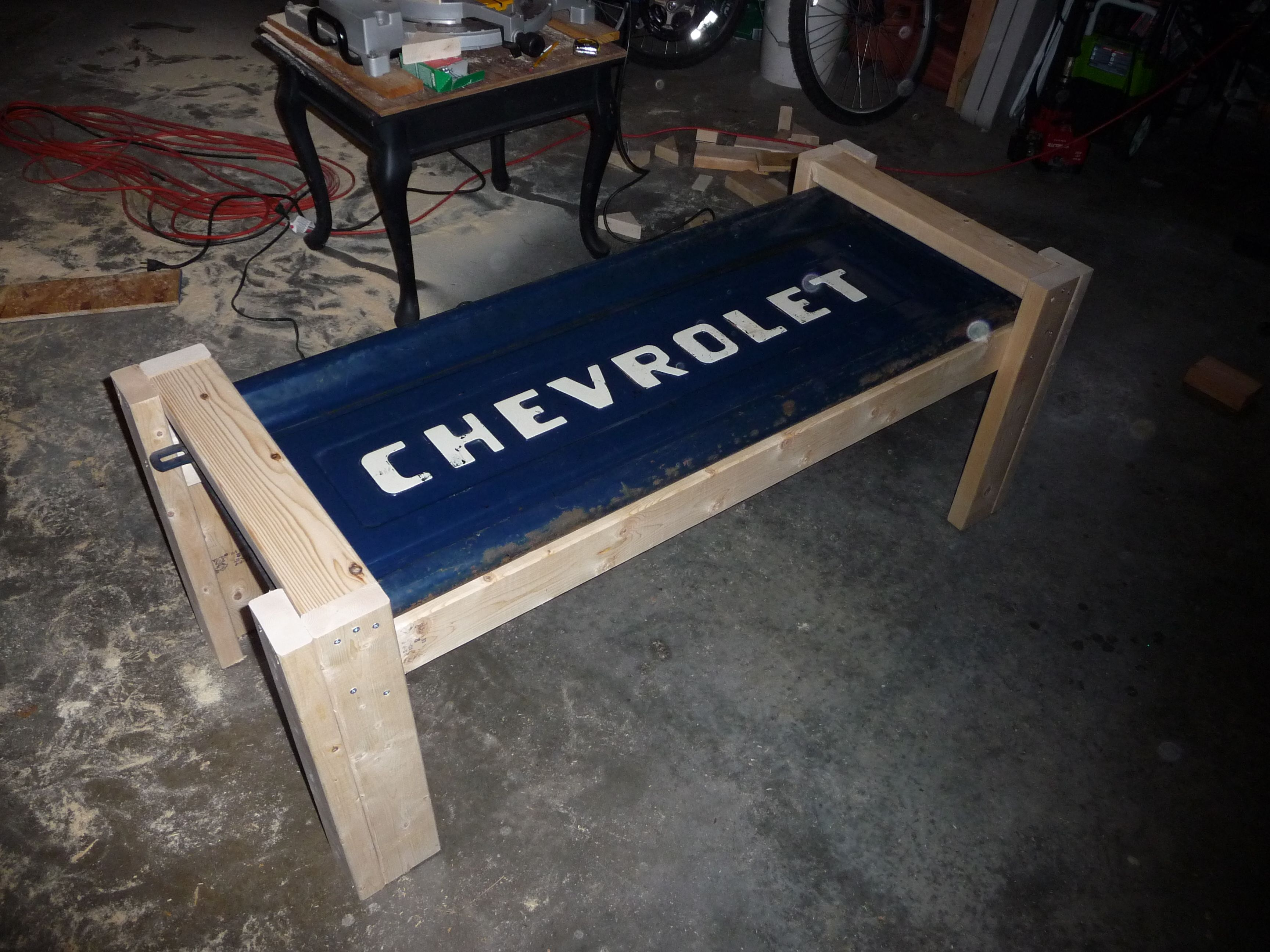I made this coffee table out of an old Chevy tailgate and some