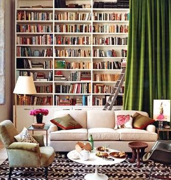 bookshelves + green velvet drapery