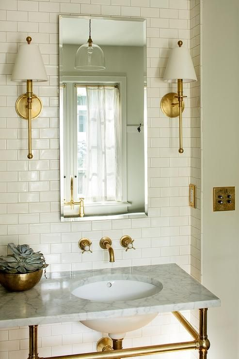 Mounted To An Ivory Tiled Wall Waterworks Newell Wall Mounted Single Arm Sconces With Shades I Wall Sconces Living Room Bathroom Sconces Bathroom Wall Sconces