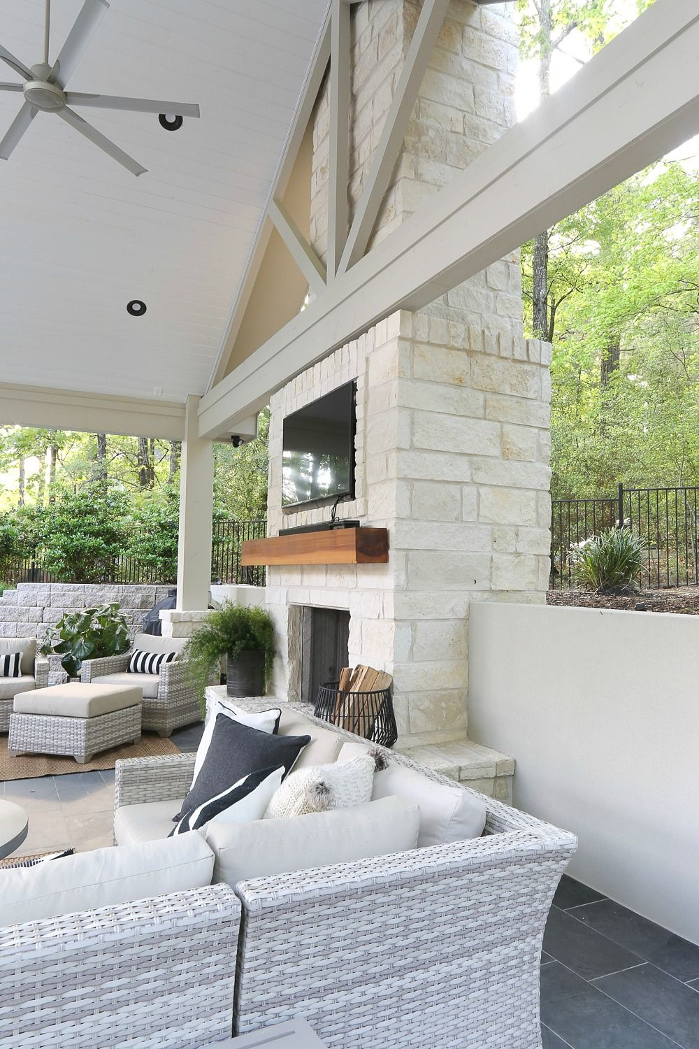Outdoor kitchen and pool house project reveal outdoor fireplace