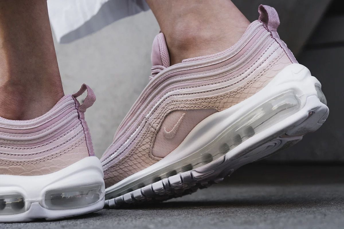 The Nike Air Max 97 Pink Snakeskin (Style Code: comes in Light Pink tones  that's layered in a mix of snakeskin leather, mesh and smooth leather