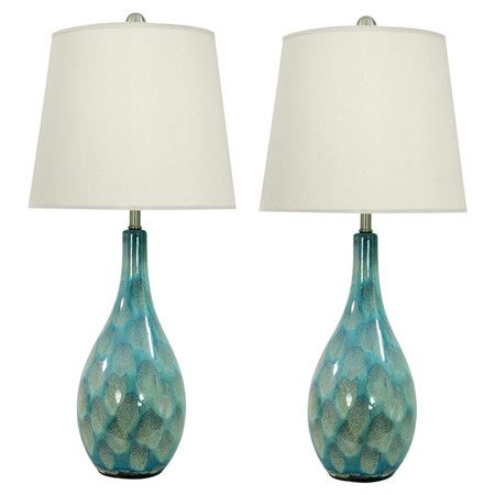 Set of two textured ceramic lamps with teal finishes and white shades.   Product: Set of 2 lampsConstruction Material: