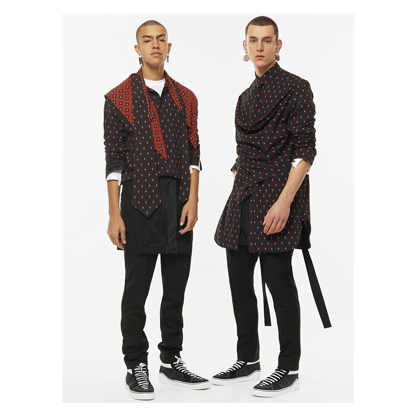 red printed Totem shirt, black overalls