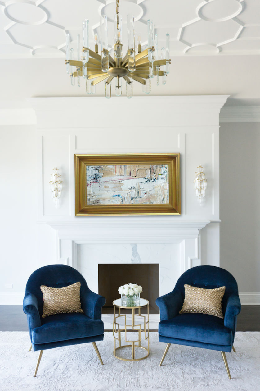 Royal Living Room Design: White Millwork Fireplace Mantel, Intricate Ceiling Detail